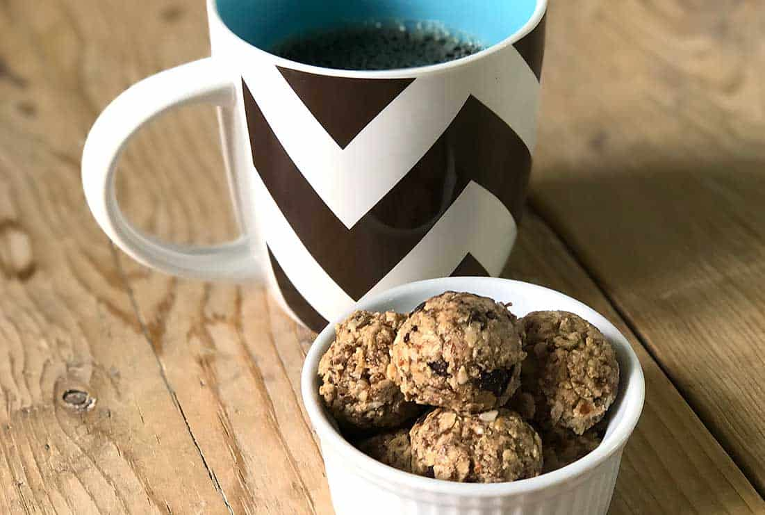 sweet and salty protein bites with a coffee mug