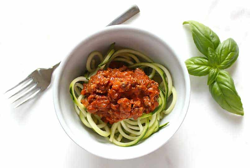 Healthy Homemade Spaghetti Sauce Recipe with Zoodles in a bowl with basil ready to enjoy