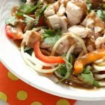 Close-up of spicy, thai peanut sauce with chicken zucchini noodles salad recipe