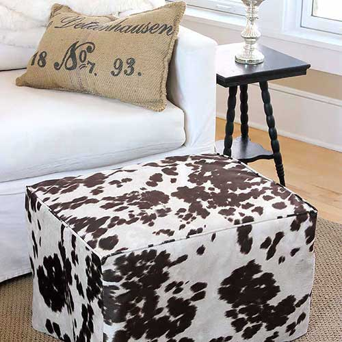 Animal print slipcover for a footstool