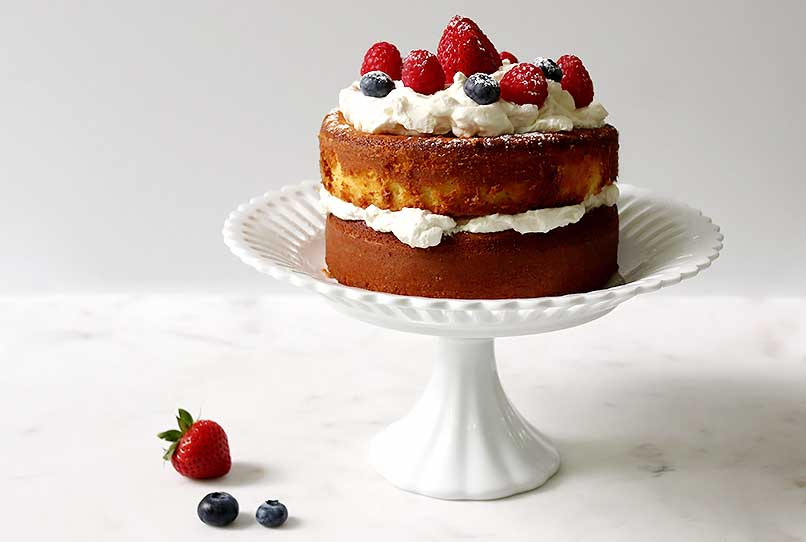A delicious and healthy strawberry keto pound cake on a pedestal