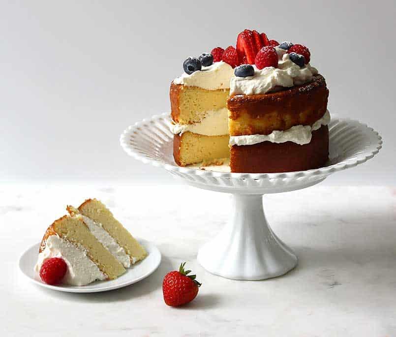 strawberry keto pound cake on a pedestal
