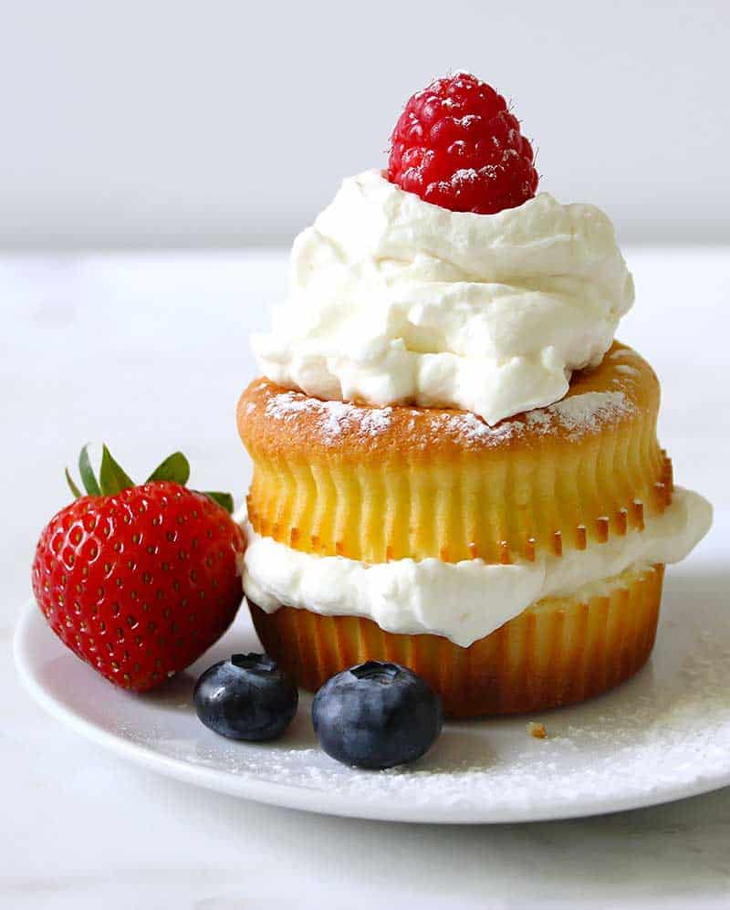 Keto homemade whipped cream dessert topping with berries