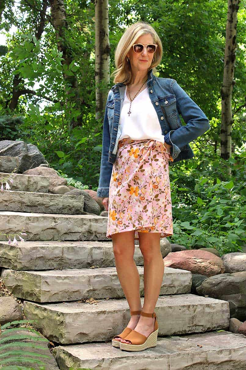 Vogue sewing pattern 8338 of wrap skirt in a flowered print with a jean jacket