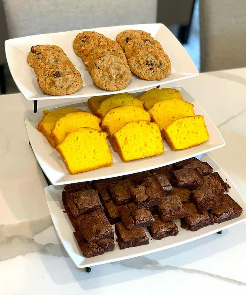 3 tier tray of desserts for hosting the perfect lunch party for your girlfriends