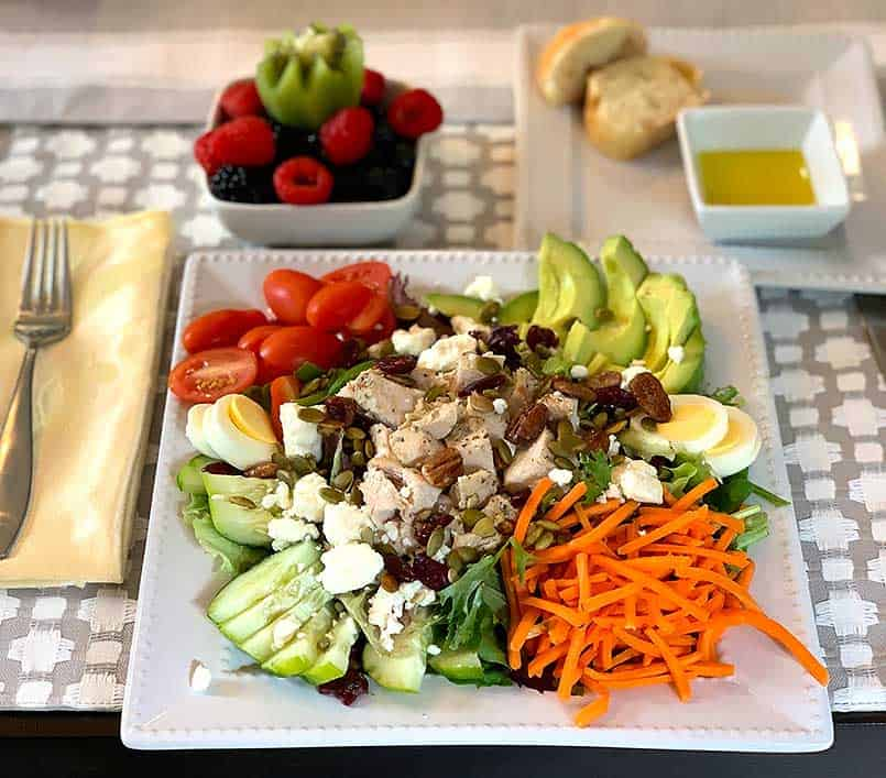 Cobb salad recipe with table decor, and table setting for lunch party
