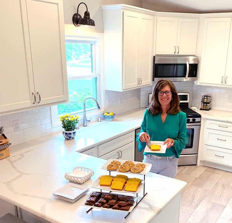 beautiful new, white kitchen design, white countertops, and white cabinets