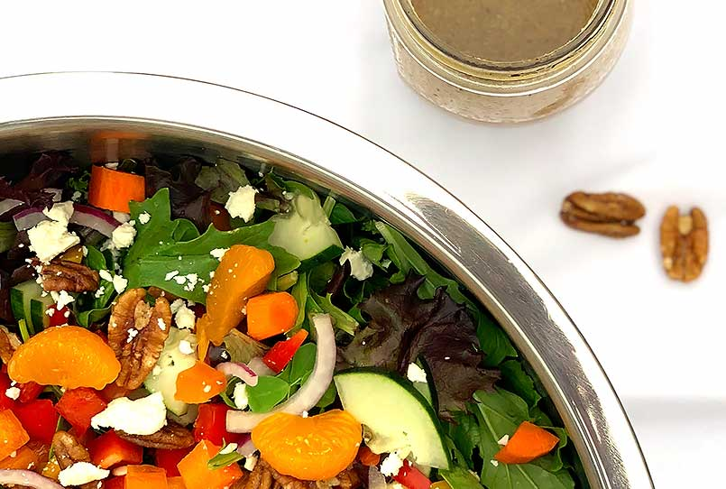 Jenny's colorful everyday vegetarian salad recipe in a stainless steel bowl