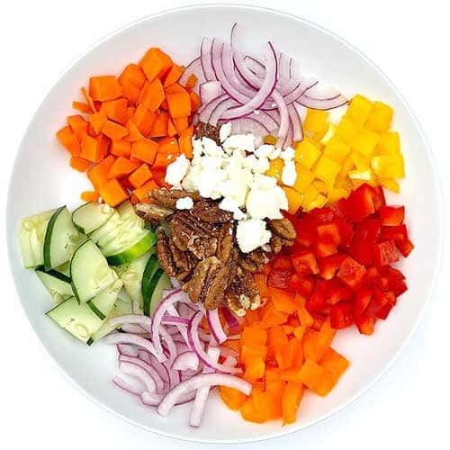 Jenny's colorful everyday vegetarian salad recipe in a white bowl