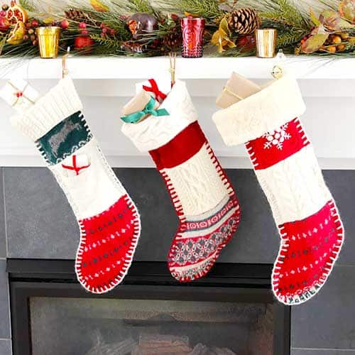 Fireplace mantle with Handmade DIY Christmas stockings made from old recycled sweaters