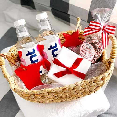 Guest room basket for hosting visitors with Hint water