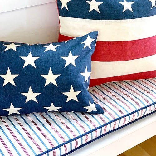 Red, white and blue diy bench seat cushions and United States flag pillows.