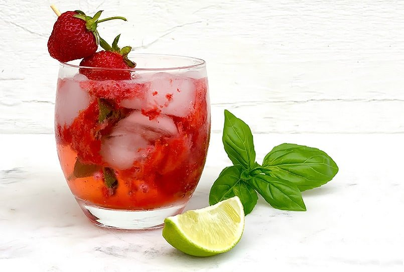 A strawberry basil gin smash in a highball glass, the best cocktail recipe for summer or the fourth of July