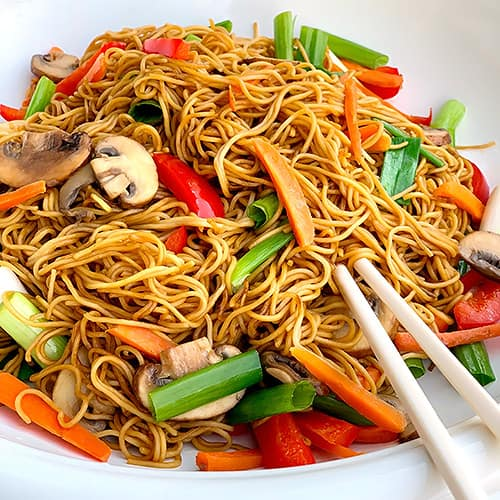 Chinese Lo Mein Noodles recipe in a white bowl with chopsticks