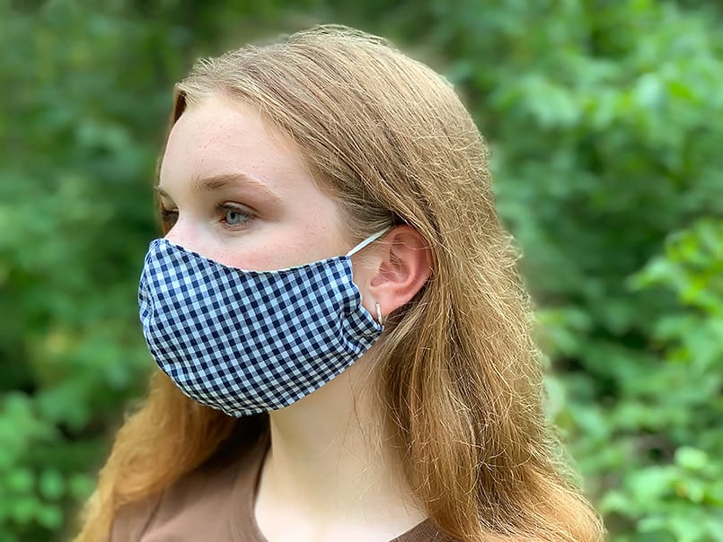 blue and white checked gingham DIY fabric face mask worn by girl with ear loops from a FREE pattern.