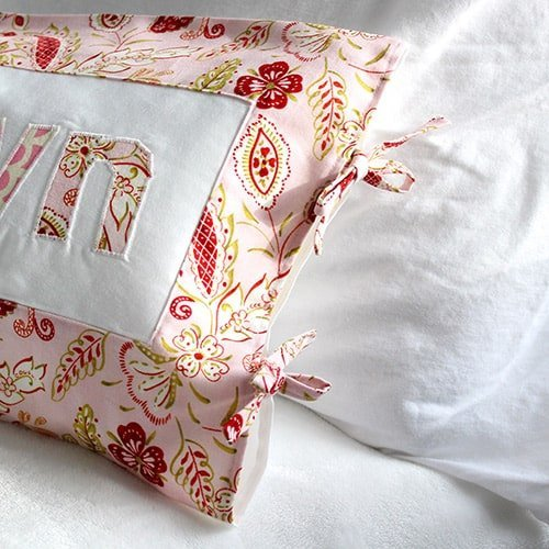 a handmade pillow with DIY fabric ties