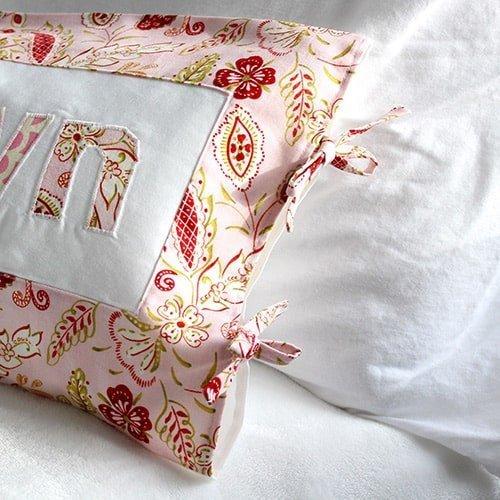 a handmade pillow with DIY fabric ties