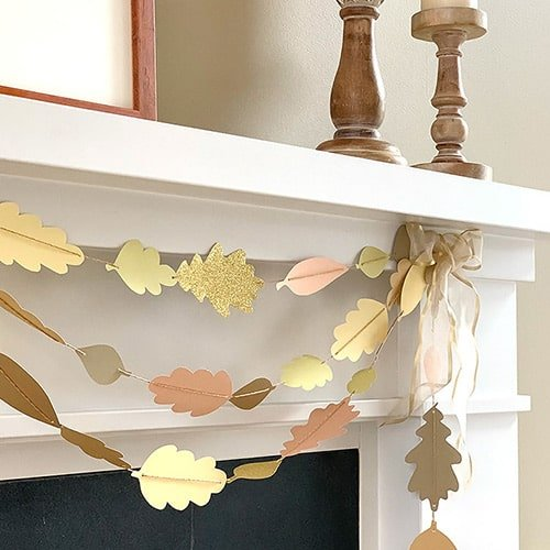 Fall leaf crafts garland on a fireplace mantle
