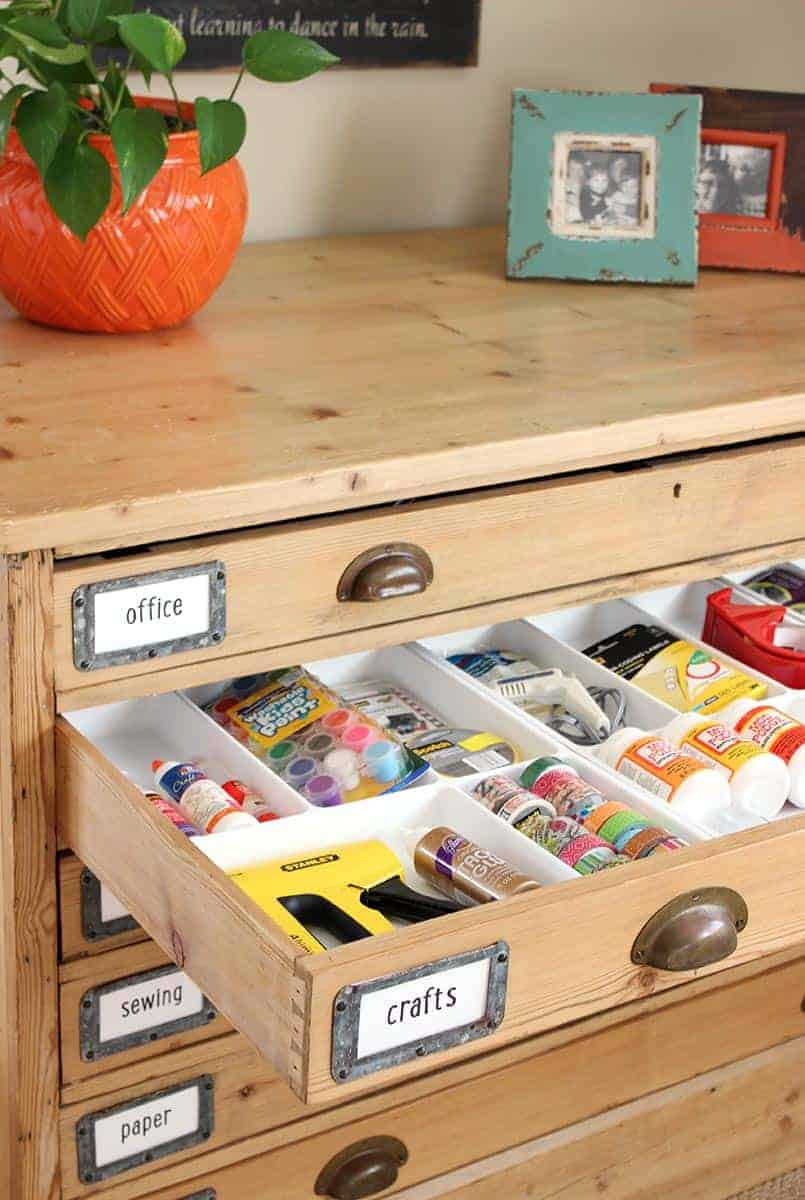 A map case in a craft room with organized storage space
