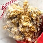 Suzi's Toffee Popcorn with Chocolate Drizzle Recipe in a red holiday gift box
