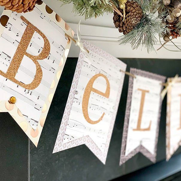 A DIY banner hanging on a fireplace mantle