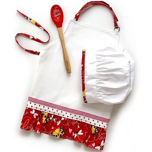 A DIY child apron, an embellished chef hat, and spoon.