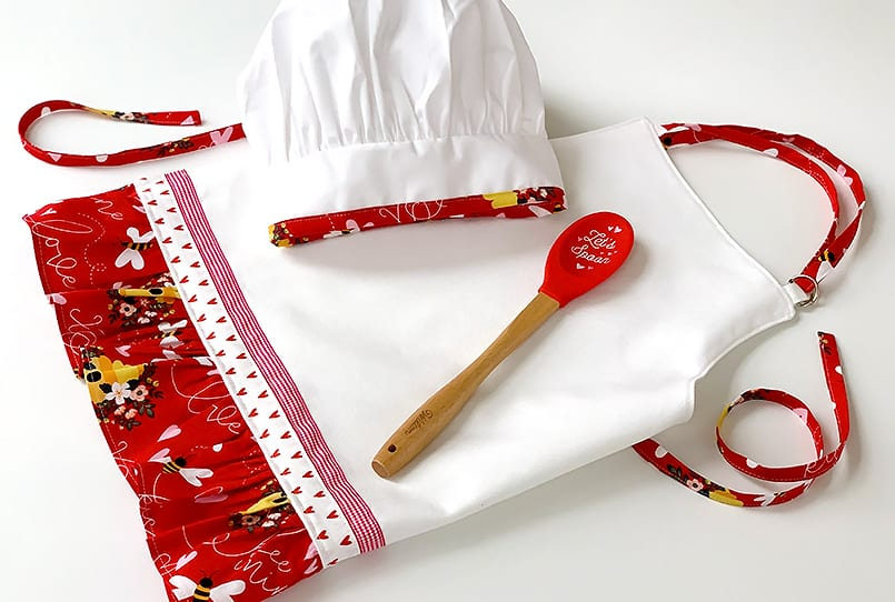 Child's chef hat and apron from a tutorial for how to make a DIY Child Apron.