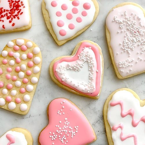 Shades of pink royal icing on the Best Cut Out Sugar Cookies.