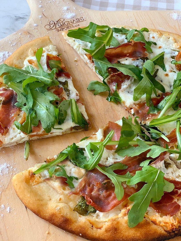 Rosemary and Prosciutto pizza slices.