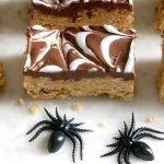 Halloween Rice Krispie Treats with 2 fake spiders.